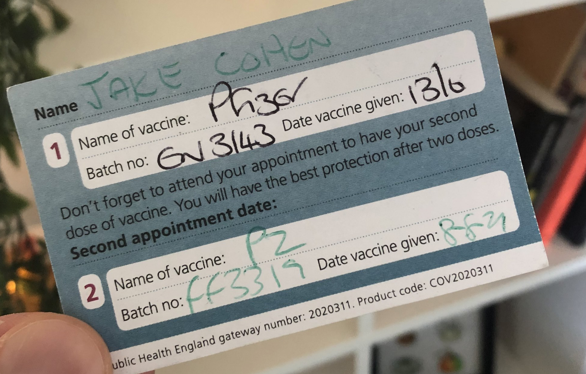 A photo of a Covid-19 vaccine appointment card